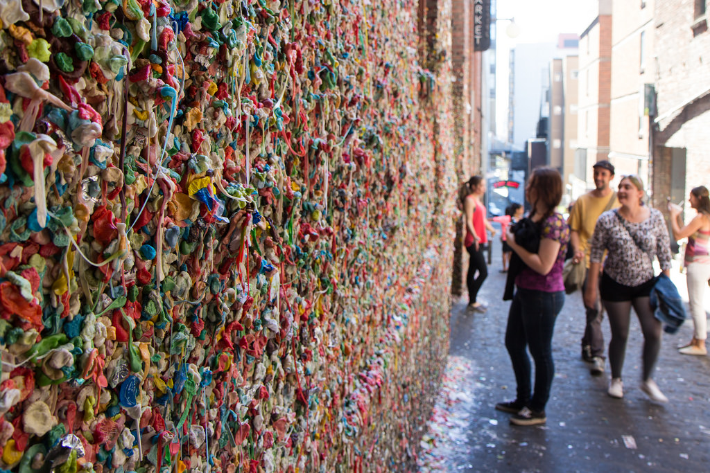 A wall covered in gum at the Seattle gum wall