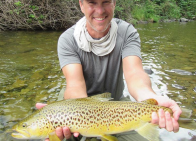 Scott holding a big trout